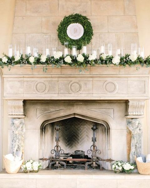 a boxwood wreath look great above a fireplace