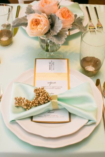 beautiful mint tablescape with a peach flower centerpiece