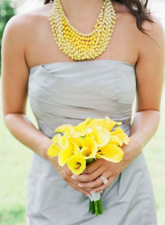 dove grey bridesmaid's dress, yellow calla bouquet and a statement yellow necklace