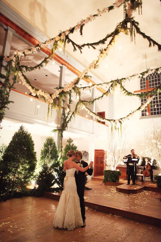 enchanted forest wedding with fir garlands and fir trees
