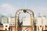 07 industrial wedding ceremony space with a wooden and fabric arbor