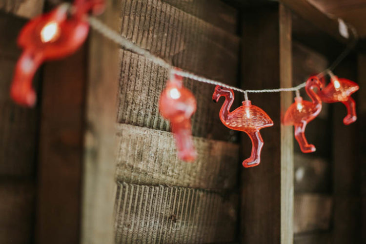 A flamingo light garland nods at the fiesta theme and tropical weddings