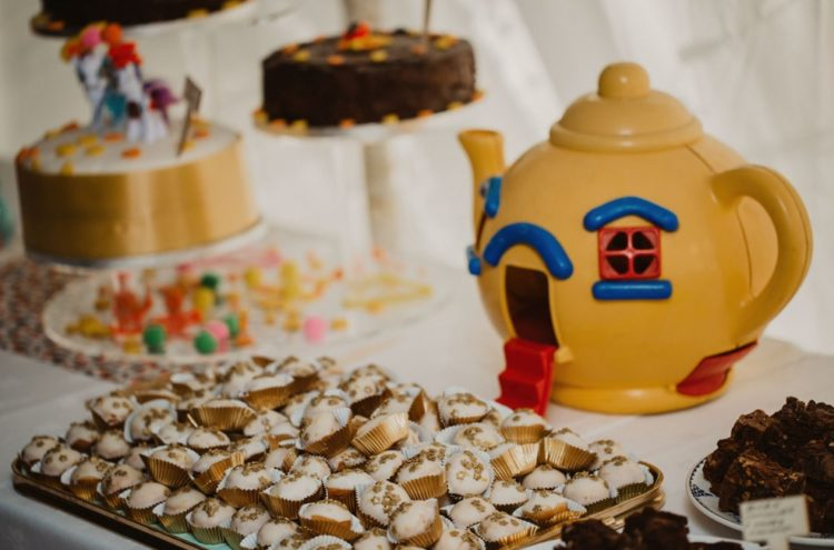 Everything was whimsy and quirky at this wedding, even the teapots and candies