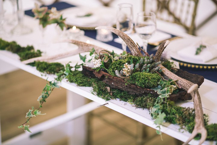 I love the centerpieces made of moss and brnaches and looking as if they have just been brought from the forest