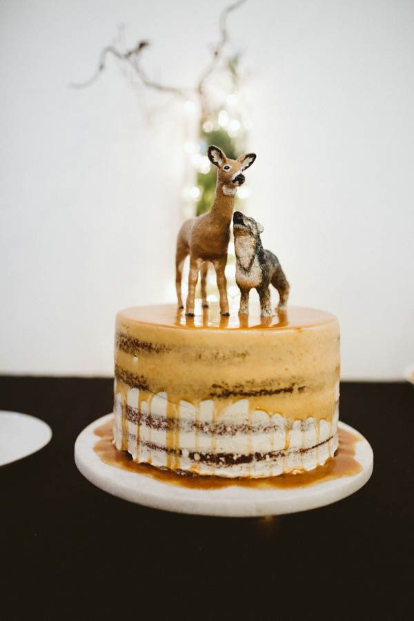 The cake toppers were inspired by the groom's second name and the favorite animal of the bride