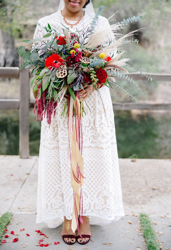 The forgy bridal bouquet is a forgy masterpiece in different colors, with ribbon and textural pieces