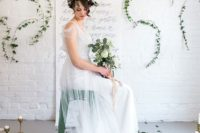 08 The wedding dress was an ethereal one, with straps and tulle, a greenery crown polished her look