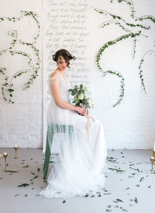 The wedding dress was an ethereal one, with straps and tulle, a greenery crown polished her look