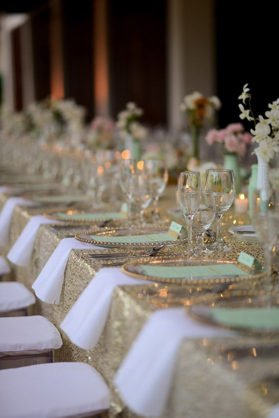 glitter gold tablecloth, mint vases and mint menus