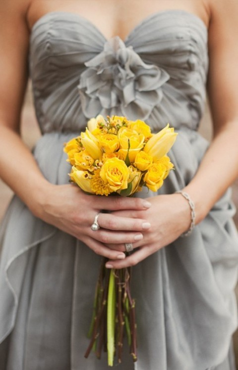 grey wedding dress and a yellow bouquet