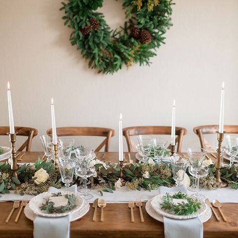 hang a fir branch wreath with pinecones in the reception