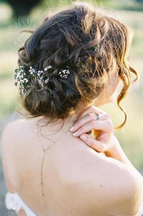 messy braided updo with fresh flowers