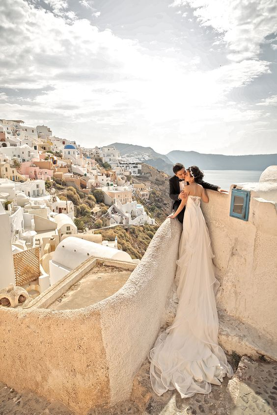 wedding photo overlooking Santorini island