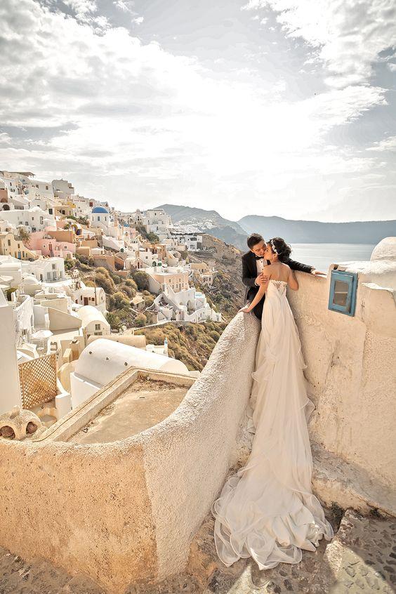 wedding photo overlooking Santorini island