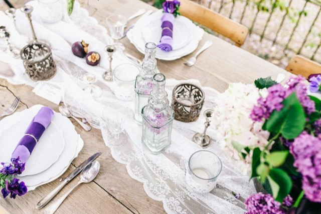 Beautiful glass bottles, subtle fabrics and lots of flowers is right what we need for a spring wedding table
