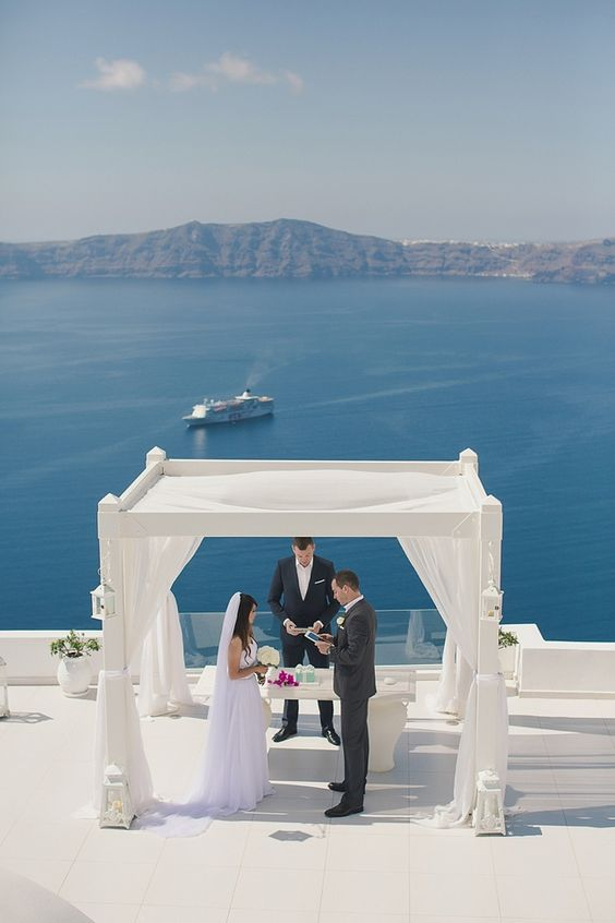 Santorini Destination Wedding Spot With A White Arch