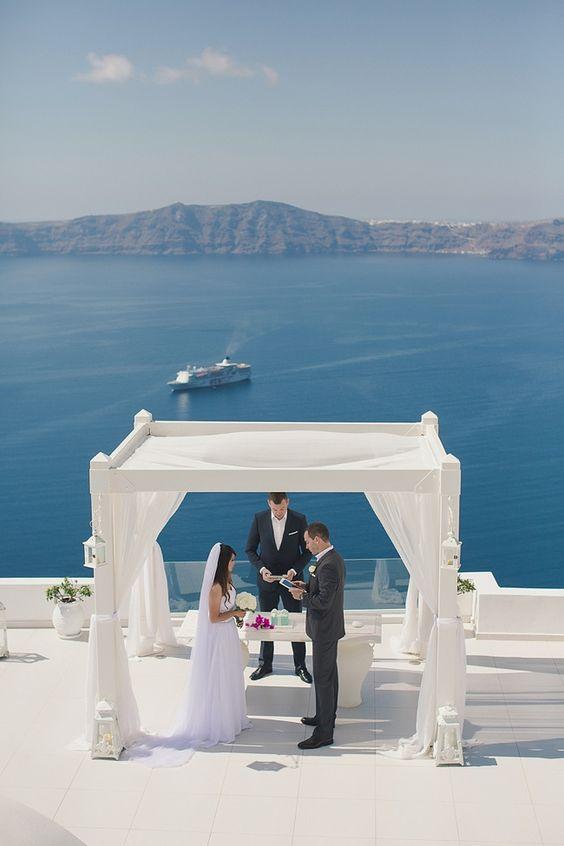 Santorini destination wedding spot with a white arch