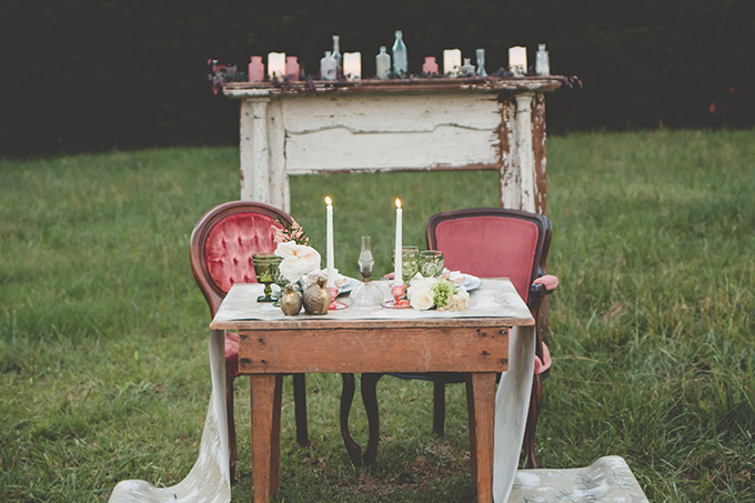 The mantel is a shabby chic one, with candle lanterns and mason jars