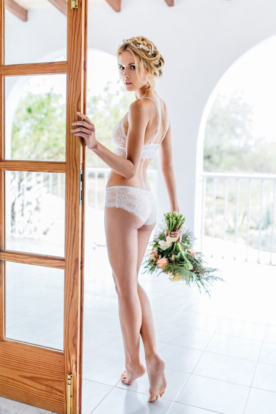 a white lace lingerie set will hint on your look on your big day