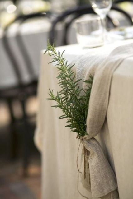 burlap table runners tied with sprigs of greenery
