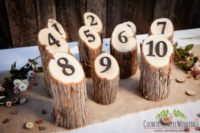 09 rustic table numbers on logs