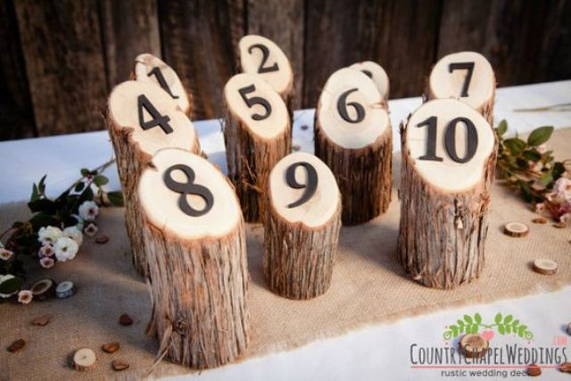 rustic table numbers on logs