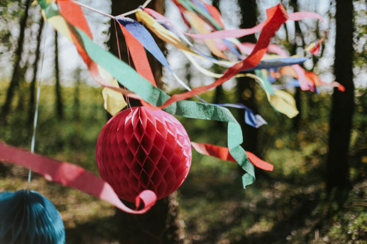 Simple paper decorations, buntings and garlands in bold colors are ideal for decorating such a colorful fiesta wedding