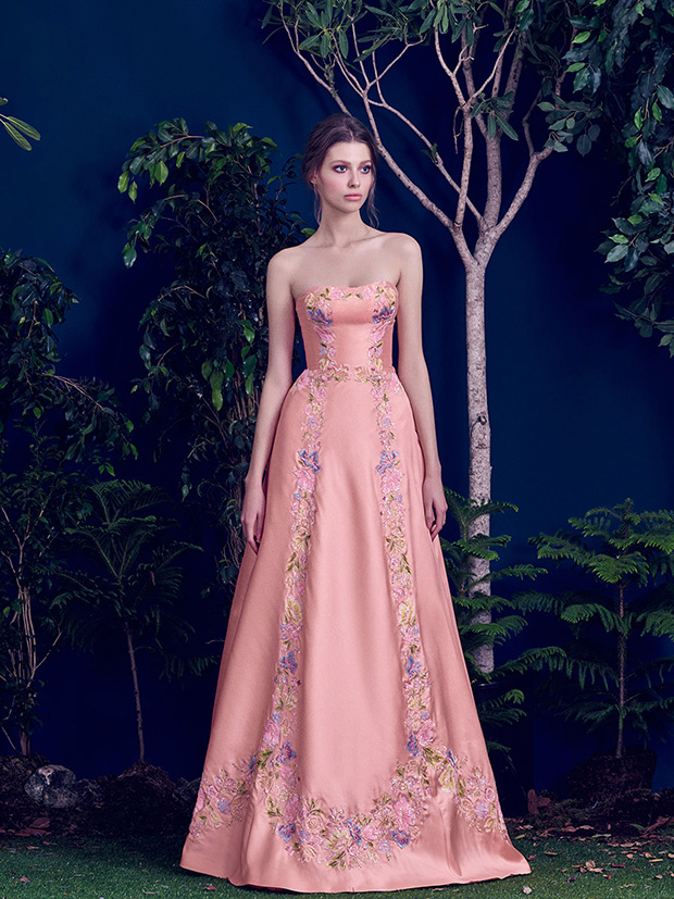 Strapless peach-colored A-line wedding dress with colorful embroidery