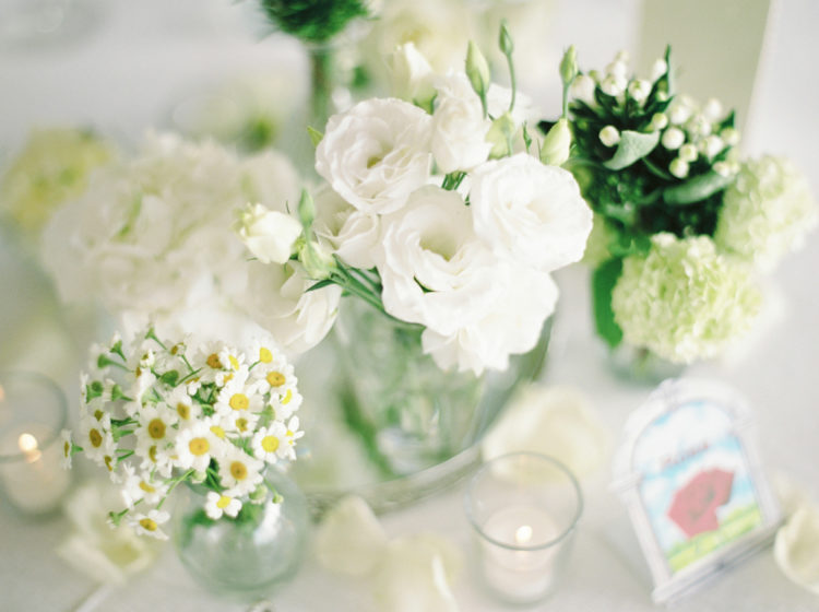 The centerpieces were of white flowers with greenery to stick to the organic Capri scenery