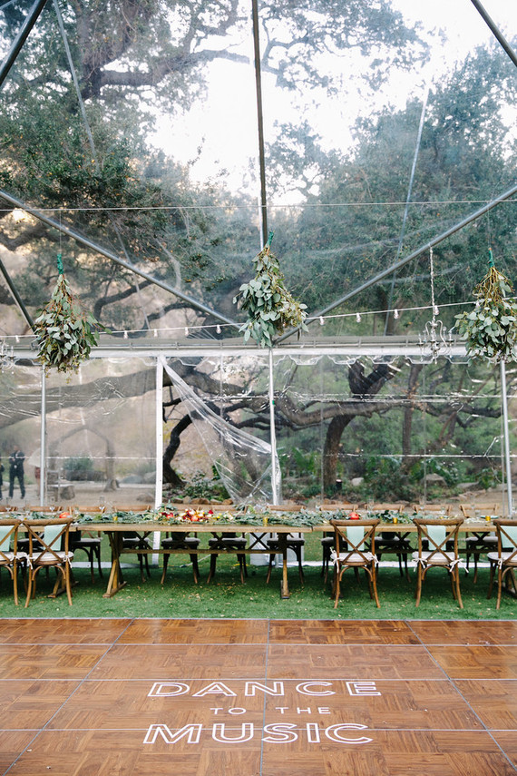 The reception was a tented one, with eucalyptus chandeliers above