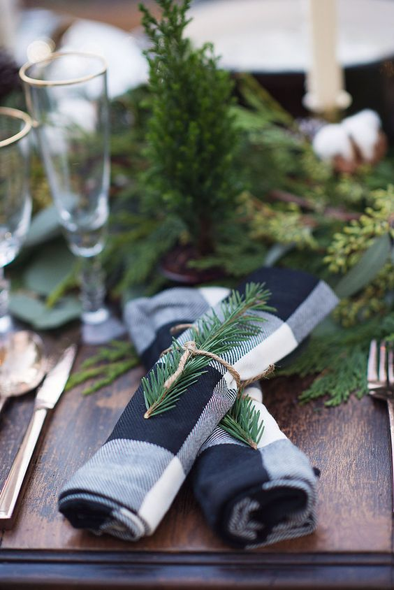 attach fir sprigs to napkins for a festive spirit
