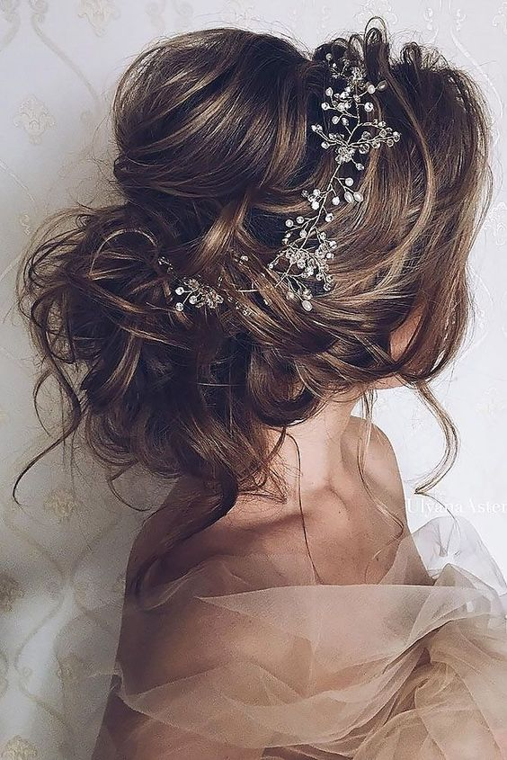 messy hair updo with a crystal headband