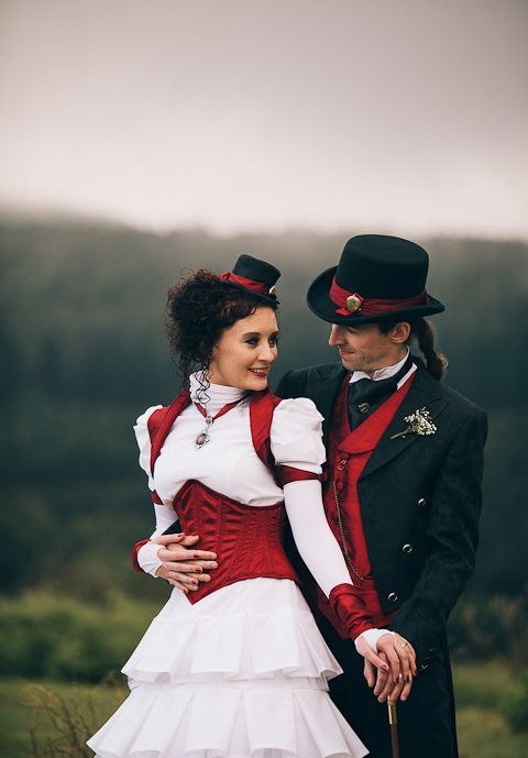 steampunk wedding couple with red accents looks chic