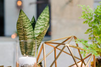 11 These cute gold geometric decorations and succulents were ideal for this modern wedding