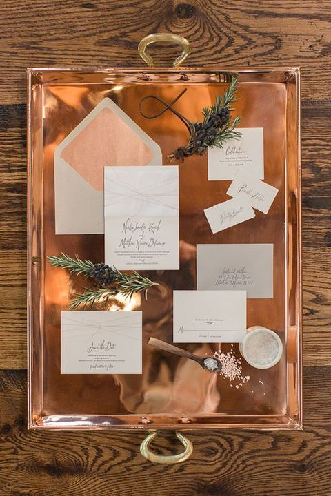 a polished copper tray with copper and white stationery looks stunning