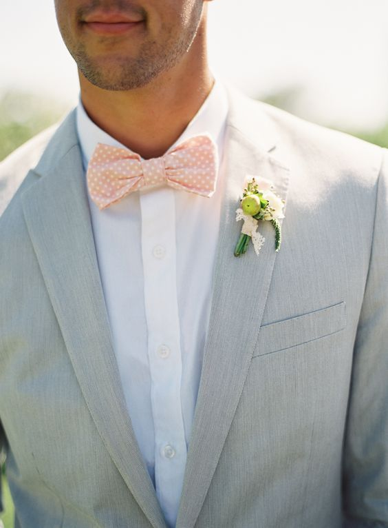 dove grey groom's suit with a white shirt and a polka dot bow tie