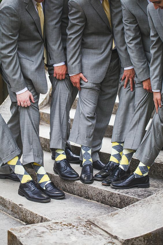 light grey suits, yellow and grey socks for the groomsmen