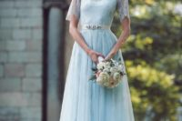 11 pale blue wedding gown with a lace top, turtleneck and short sleeves and an embellished belt