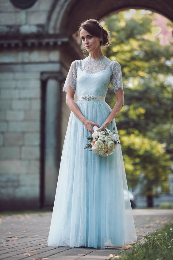pale blue wedding gown with a lace top, turtleneck and short sleeves and an embellished belt