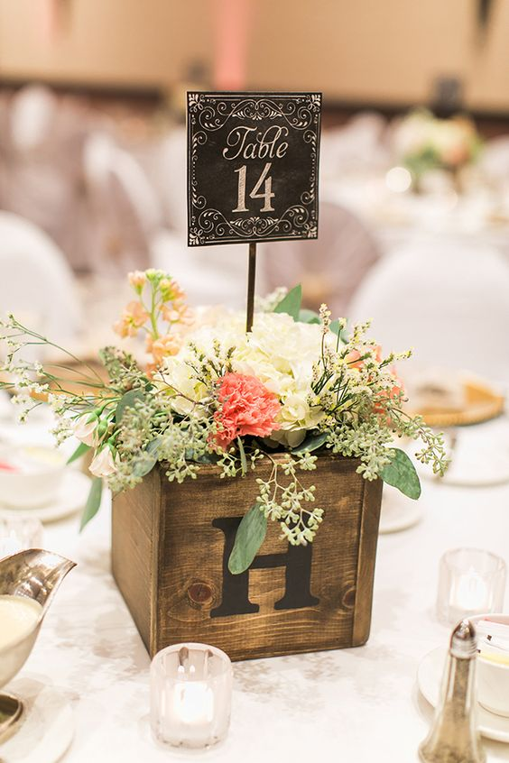 wooden box with flowers and a vintage printed table number