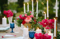 12 Candles and bold florals created a mood and made the table settign vibrant