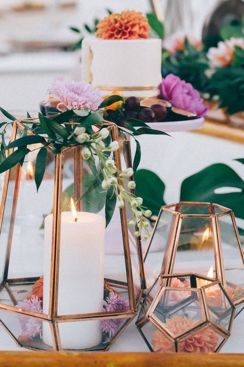 a totally elegant way to fuse candles and florals for striking centerpieces