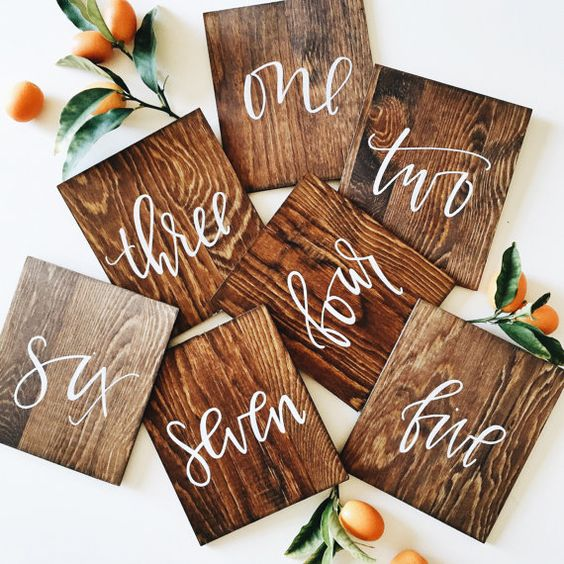 hand lettered calligraphy wood table numbers