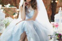 12 pastel blue A-line wedding dress with an illusion neckline