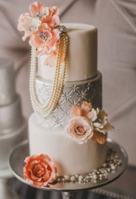 vintage silver and ivory wedding cake with peach flowers and pearls