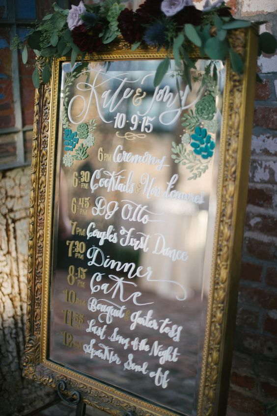 wedding program painted on a framed mirror