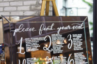 13 The wedding seating chart was painted on a large mirror