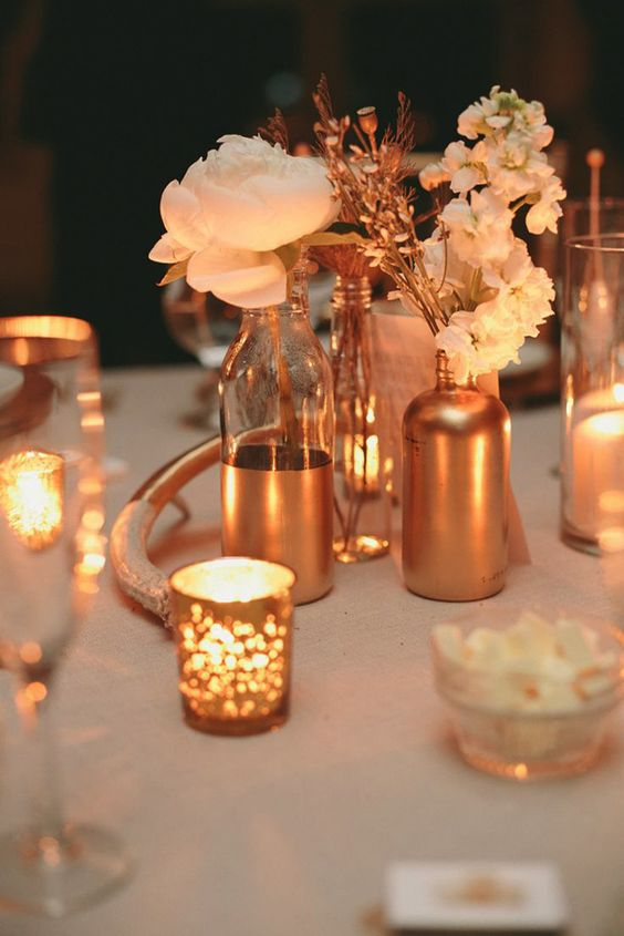 add a sparkle to your wedidng decor with copper vases and candle holders
