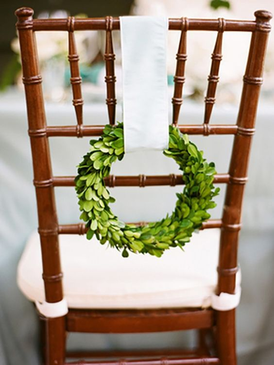 little evergreen wreaths with cream ribbon will elegantly hint on the holidays