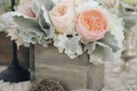 13 soft wedding centerpiece with dusty miller and blush peonies